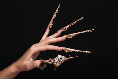 Creative design of nails on female hands. Art manicure. Photo taken in studio
