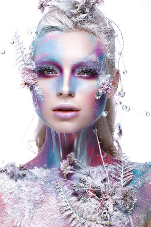 Beautiful girl in the image of a snowy unicorn creature. Creative make up. Art looks. Photo taken in the studio. Stock Photo
