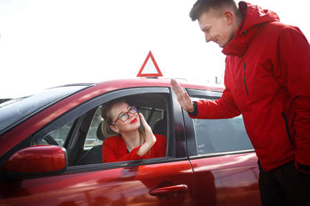 The driver is an auto school instructor and a female student on an examination car. Lesson at the circuit Stok Fotoğraf