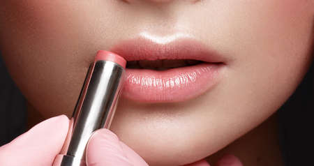 Close-up of female lips with lipstick. Lip makeup cosmetics