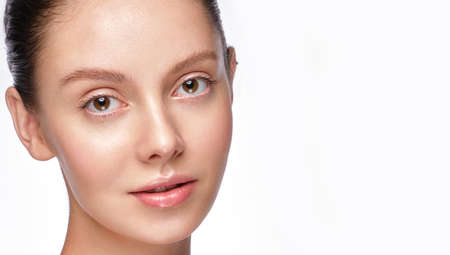Portrait of beautiful woman with light natural make-up and perfect skin.