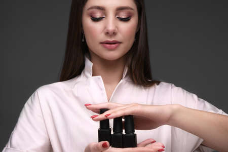 Manicurist in working form with tools in hand.