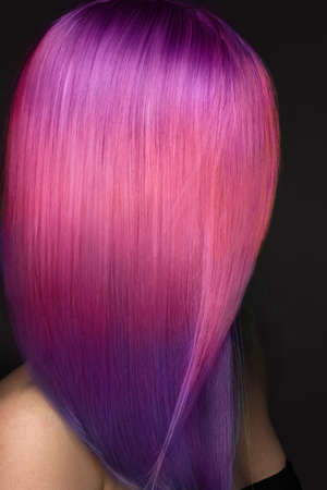 Beautiful woman with multi-colored pink and purple hair . Banque d'images