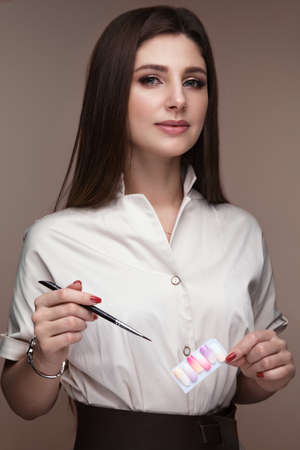 Manicurist in working form with tools in hand. Nail photo content