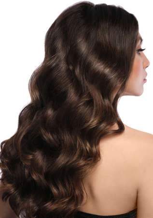 Beautiful brown-haired girl with a perfectly curls hair, and classic make-up. Beauty face and hair.