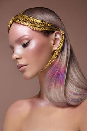 Beautiful girl with multi-colored hair and creative make up and hairstyle. Beauty face.