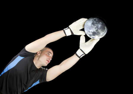 soccer goalkeeper whit the moon ball in his hands