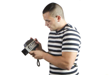 young man with camera recording old home theater
