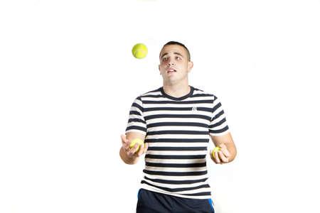 man juggling tennis ball Stock Photo