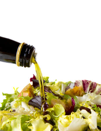 mixed salad lettuce to a jet falling olive oil
