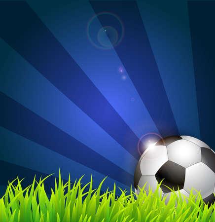 Soccer ball on grass background