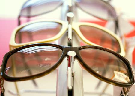 Sunglasses close up shades and sunglasses in optician s shop photo