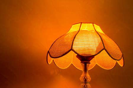 lamp shade: Lighting home lamp besides stucco wall