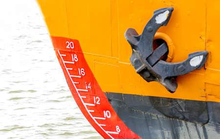 ship bow: bow of a ship with draft scale numbering and  anchor - focus on scale numbering Stock Photo