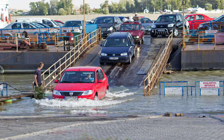 galati: GALATI, ROMANIA -SEPTEMBER 28,2014,cars coming down from the ferry transport across the Danube flooded Editorial