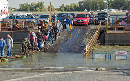 galati: GALATI, ROMANIA -SEPTEMBER 28,2014,Danube River flooding,People descended from the ferry an improvised passage Editorial