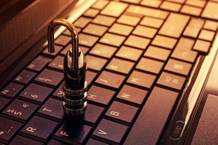 internet banking: keyboard unlock - security concept padlock with key on keyboard