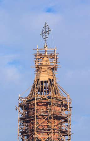 Church steeple in scaffolding photo
