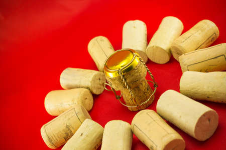 stopper: Champagne stopper surrounded by cork stoppers