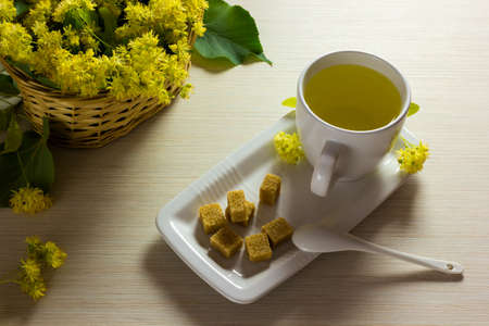 linden tea: Linden tea cup and woven basket with linden flowers  Tea time Stock Photo