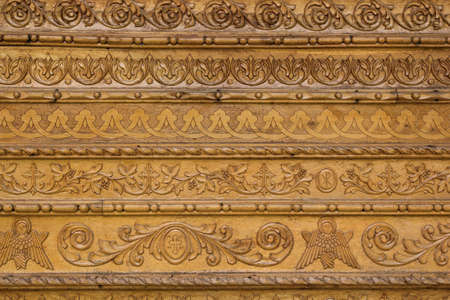 carvings: Close up ornamental wood  carvings on the wall of monasteries in Bucovina Stock Photo