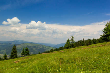 blue cloudy sky: Mountain landscape with blue cloudy sky Stock Photo