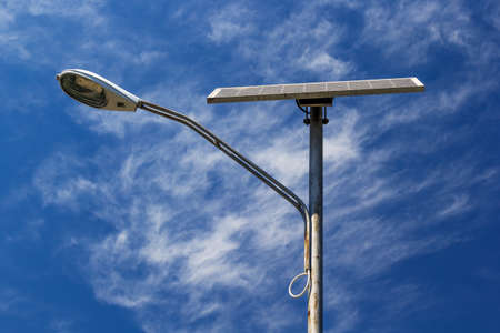 street light: Solar powered street light with blue sky and clouds