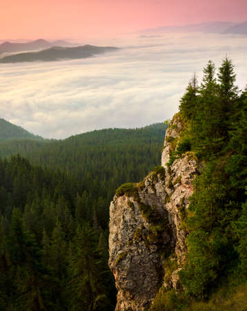 large rock: Large rock  illuminated at sunset  sunrise with the Carpathian mountains in the background