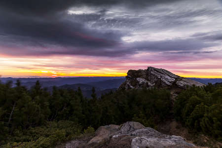 mountaintops: Sunrise in the mountains with spectacular sky one morning stormy