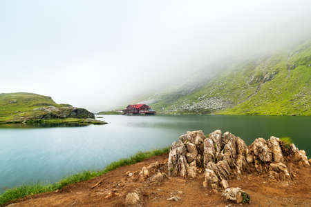 balea: Glacial lake misty morning.The Balea Glacial Lake on Fagaras ,Romania Stock Photo