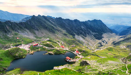Balea Lake, seen from above. Glacial lake, on Transfagarasan highway in Carpathian mountains, Romania in summer
