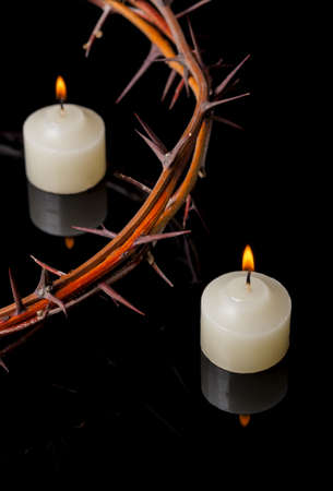 Crown of thorns of Jesus Christ at candles lights Reklamní fotografie