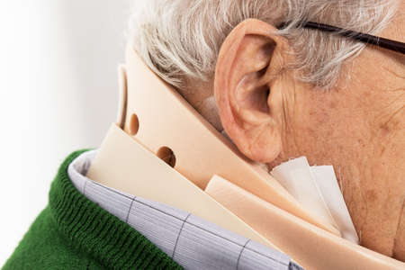 Close-up of old man with a surgical cervical collar after the operation Stock Photo