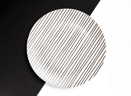 White plate with lines isolated on black and background