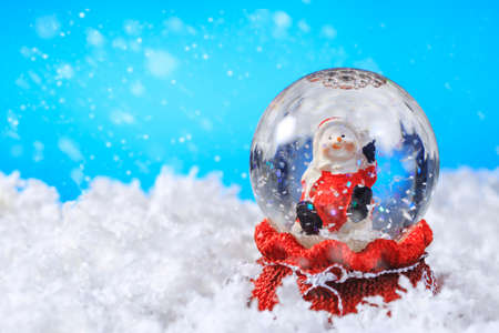 Christmas snow globe on snow,Useful as Christmas background card