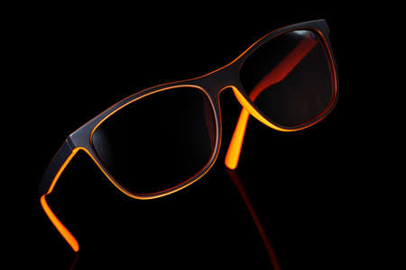 Eyeglass on black background. Studio shot