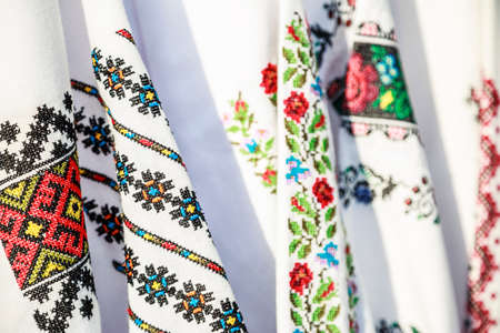 Close-up Romanian traditional embroidery on costumes. Close up of traditional Ie Romanian clothing.