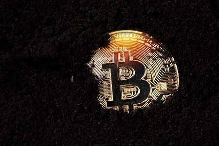 Bitcoin in the ground. Mining Golden Bitcoins concept Фото со стока - 116709124