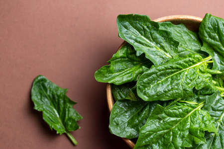 Fresh spinach leaves in bowl on table. Washed fresh spinach in bowl with place for text 写真素材