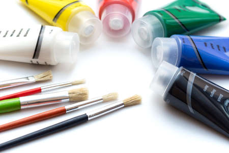 Acrylic color tubes and brushes. Tube of several acrylic colors with brushes