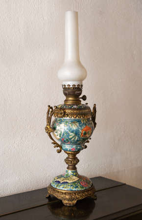 Old ceramic Oil lamp on table