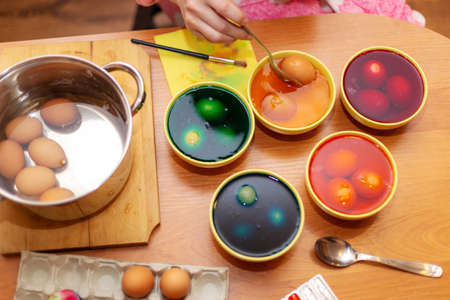 Dyed Easter eggs, High angle view of Easter Egg dying.