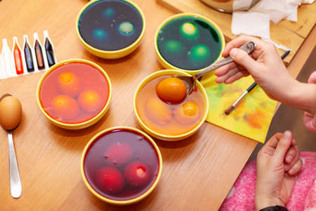 Person who painting easter eggs,  Dyed Easter eggs