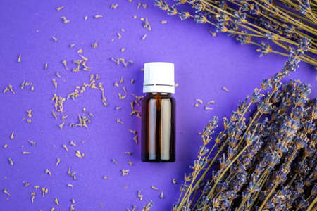 Bottle with aromatherapy in lavender flowers with place for text, Essential oil and lavender flowers presentation mack-up