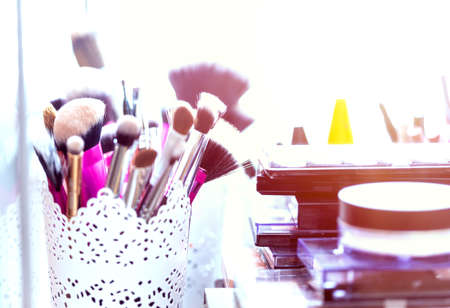 Professional makeup brushes and tools. Various makeup products. Makeup brushes, closeup Фото со стока