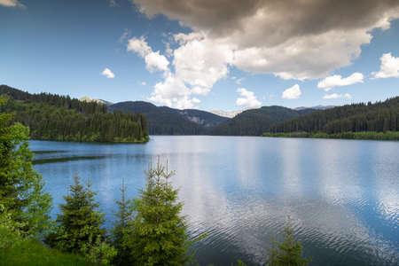 View of Lake Bolboci in Bucegi Mountains, Romania. The Bolboci Dam Фото со стока
