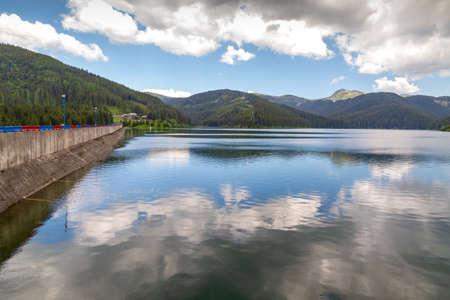 View of Bolboci Dam in Bucegi Mountains, Romania on sunny day Фото со стока