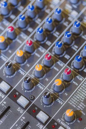 Close up shot detail sound mixer control panel button Фото со стока