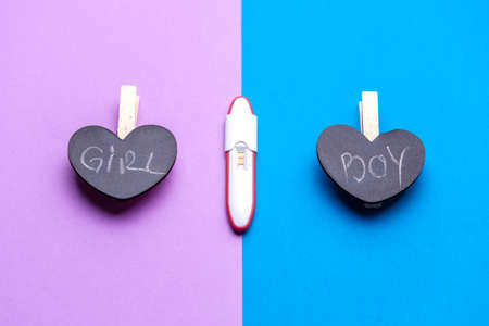 Its a Boy or girl? Pregnancy test with Its a boy or girl concept over pink and blue background Reklamní fotografie