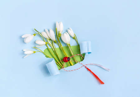 Spring greeting card made from torn paper with Snowdrops (Galanthus nivalis) flowers. 8 March, Martisor, Baba Marta holiday concept. Place for text